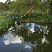 Dramatic Rainbow Glass Rope Bridge by Adam Aaronson
